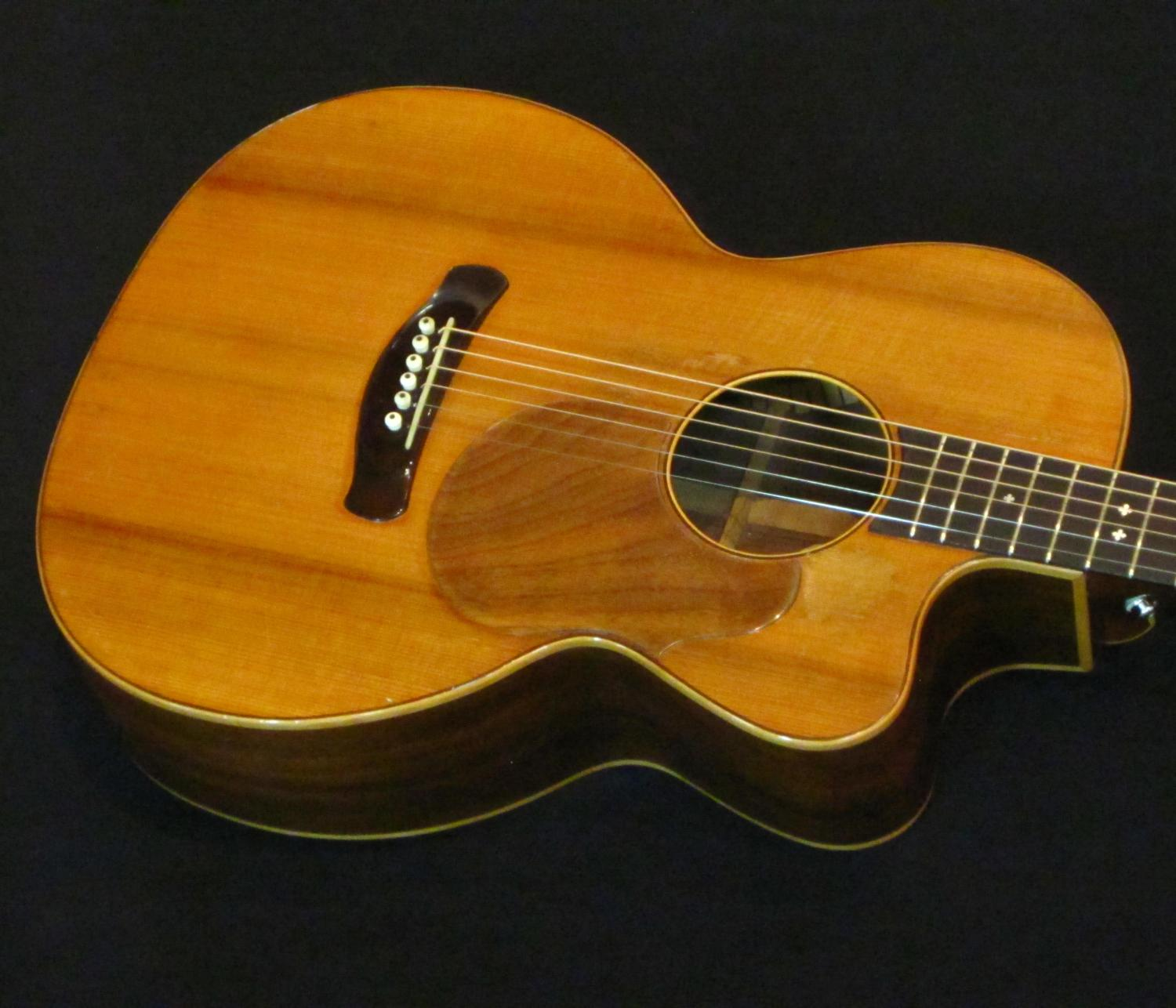 Airline damage guitar repair by Nicole Alosinac Luthiery.